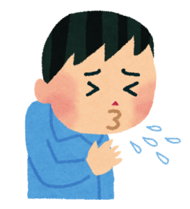 くしゃみをする男性